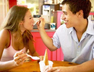 couple feeding yogurt